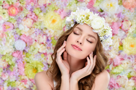 sensual young woman in floral wreath with perfect skin Stock Photo