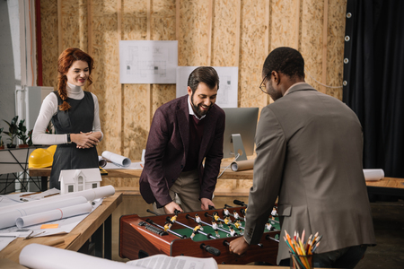 architects playing table football at modern office Stok Fotoğraf