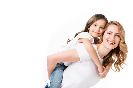 happy mother and daughter piggybacking together isolated on white Stock Photo