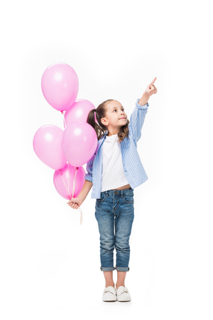 adorable little kid with pink balloons pointing away isolated on white