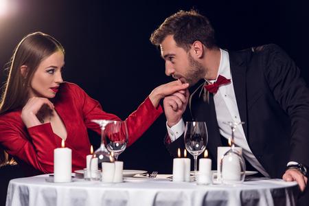 man kissing hand of his girlfriend on romantic date in restaurant Standard-Bild - 114547931