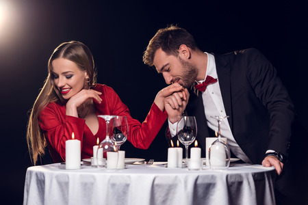 happy beautiful couple spending time on romantic date in restaurant