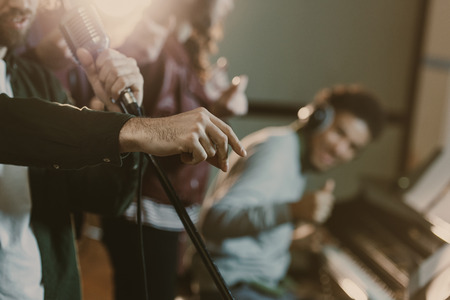 cropped shot of musicians performing song at studio Archivio Fotografico