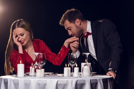 man kissing hand of his beautiful girlfriend on romantic date in restaurant Standard-Bild - 114547673