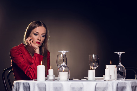 alone sad beautiful woman waiting for romantic date in restaurant Reklamní fotografie