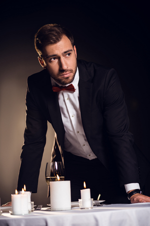 upset man in jacket waiting for romantic date in restaurant 写真素材