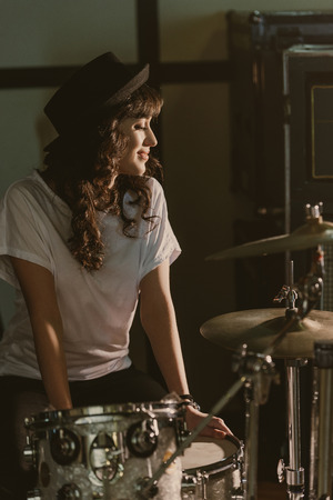 beautiful female drummer sitting at drum set Фото со стока - 114548383