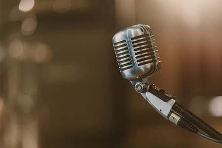 close-up shot of vintage microphone on blurred background Imagens