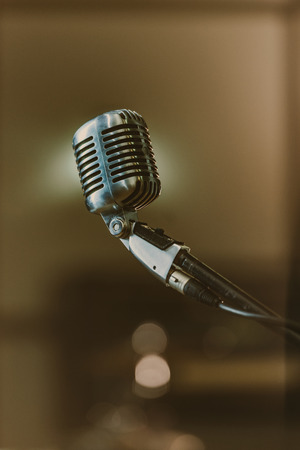 close-up shot of retro microphone on blurred background