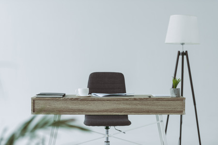 chair and wooden table in office isolated on gray Stock fotó