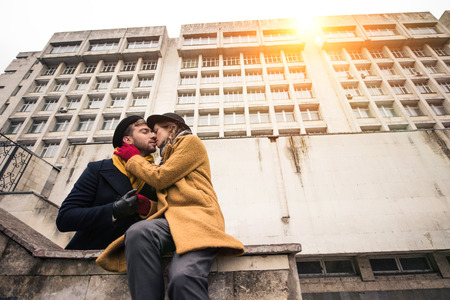 cheerful attractive young couple hugging infront of building Stock fotó