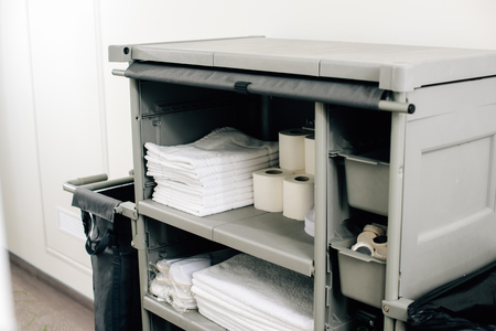 close-up shot of housekeeping cart with clean towels at hotel