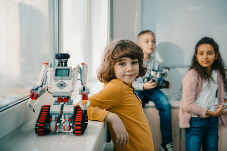 adorable little schoolboy with diy robot on stem education class Stock fotó