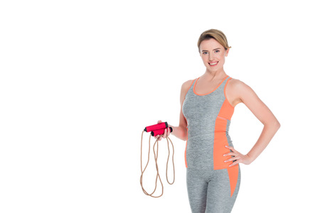 portrait of smiling sportswoman with jumping rope isolated on white Reklamní fotografie