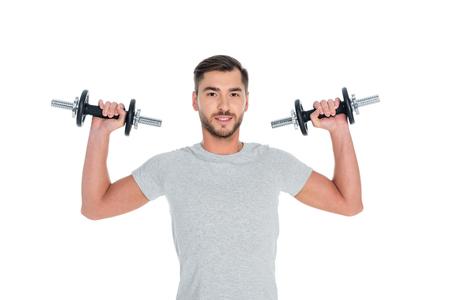 portrait of sportsman exercising with dumbbells isolated on white Reklamní fotografie