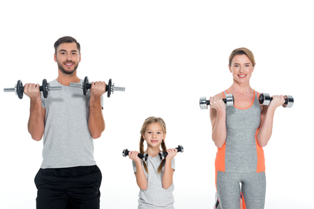 portrait of sportive parents and daughter with dumbbells isolated on white