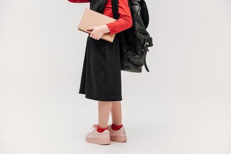 cropped shot of little schoolgirl isolated on grey Banco de Imagens