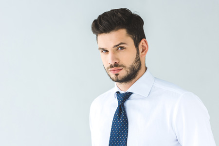handsome businessman in white shirt and tie, isolated on grey