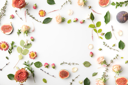 floral concept with flowers, leaves, petals, buds and figs isolated on white