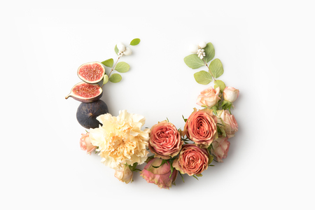 pink flower wreath with leaves, buds, figs and petals isolated on white
