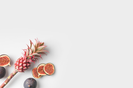 pink pink pineapple with figs isolated on white