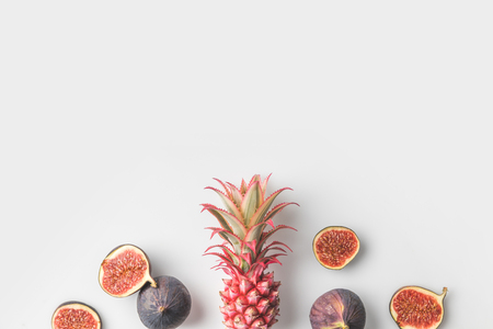 pink pineapple with figs isolated on white