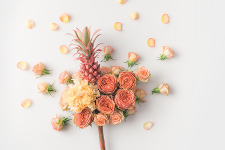 pink pineapple in flowers bouquet isolated on white Stock Photo