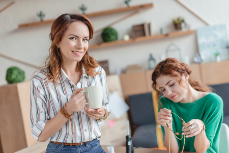 young women spending time in handmade accessories workshop Stock Photo