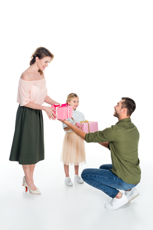 man presenting gifts to family isolated on white, international womens day concept