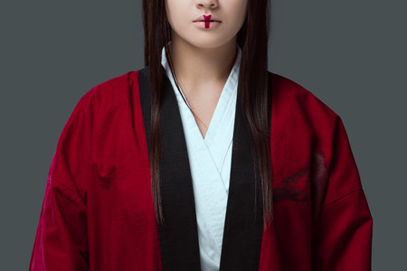 cropped shot of young asian woman with make up wearing kimono isolated on grey