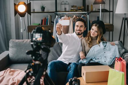 happy beauty bloggers taking selfie with new jean jacket