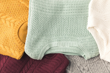 top view of warm knitted sweaters