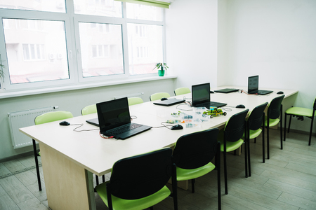 interior of classroom with laptops on desk at stem education courses 스톡 콘텐츠