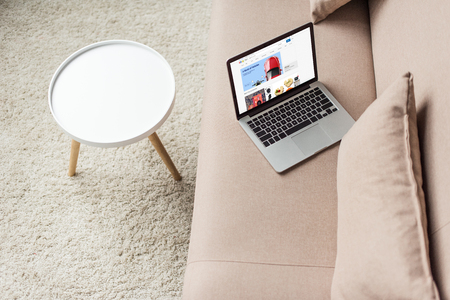 high angle view of laptop standing on cozy couch with ebay website on screen 新聞圖片