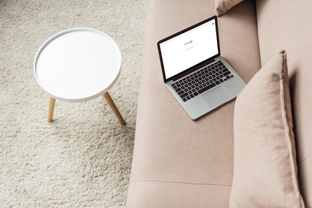 high angle view of laptop standing on cozy couch with google website on screen 新聞圖片