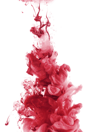 red paint splash in water, isolated on white Banco de Imagens