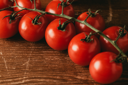 close up of Cherry tomatoes on wooden tabletop Stock Photo