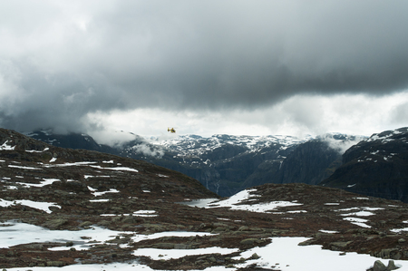 Views of the mountain sightseeing tour helicopter in sky over Norwegian mountains , Norway.