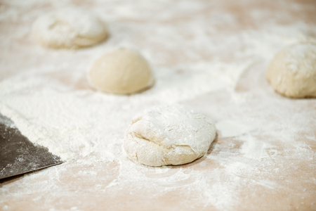 close-up shot of dough ball on table spilled with flour Фото со стока - 114406386