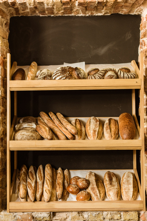 arious rural bread on shelves at pastry store
