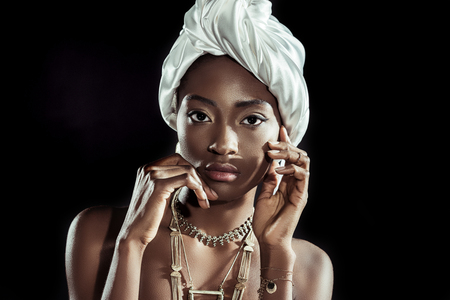 stylish african american woman in white wire head wrap isolated on black