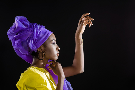 young african american woman in stylish retro clothing isolated on black Stock Photo