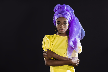 young african american woman in stylish vintage clothing isolated on black Foto de archivo