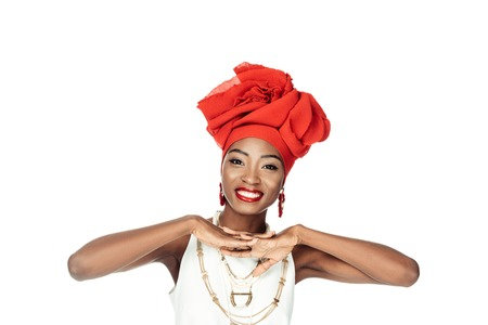 smiling african american woman in wire head wrap isolated on white Stock Photo