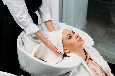 cropped image of hairdresser drying washed customer hair with towel Banco de Imagens