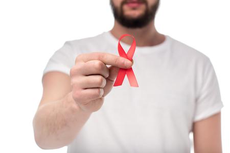 cropped shot of man holding aids ribbon isolated on white Stock Photo