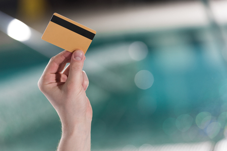 cropped shot of man holding credit card in spa center Фото со стока