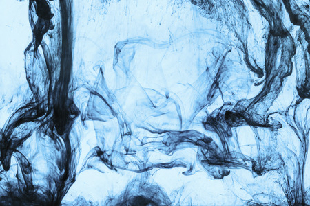 background with swirls of blue paint in water Banco de Imagens