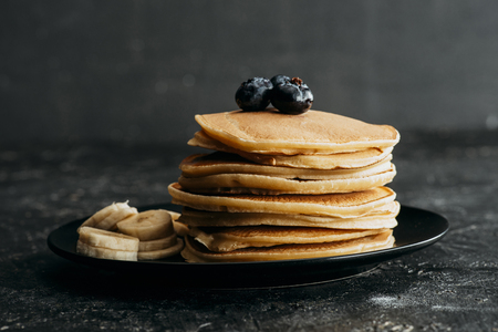delicious stacked pancakes with blueberries and sliced banana Reklamní fotografie