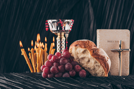 chalice, holy bible, christian cross, candles and food for Holy Communion 스톡 콘텐츠